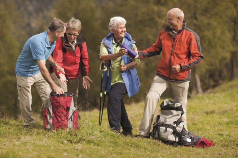 four senior hikers enjoying their day